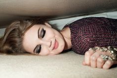 under the bed with deep smokey eyes.