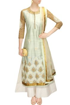 Anoli Shah This set features a mint green straight cut kurta in raw silk with dori embroidery and gold work applique sleeves.  It comes along with off white chanderi sharara pants and off white net dupatta with go