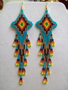 These Beautiful Native American Beaded Earrings are custom made by Elaine out of Turquoise, Black, Copper, Red, Orange, Yellow, and Green.