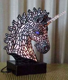Unicorn Stained Glass Lamp, by Arkie Pisello  I am the proud owner of this beautiful sculpture.