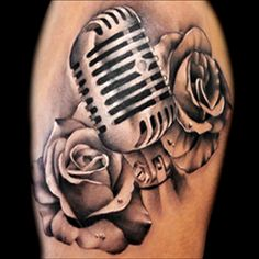 Realistic microphone and roses tattoo done in black and grey by Brandon Marques. Timeless Tattoo Studio, Toronto, ON. For appointments and info visit our website or email: info@timelesstattoos.ca.