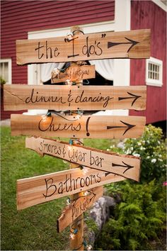 Wooden directional sign for the outdoor venue