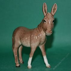 "Antiques Atlas - Beswick Donkey Foal Model No. 2110 Designer Graham Tongue Colour Grey/Brown, Glossy circa 1968-2002 4.5"" H sold for $54.65"