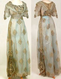 Gown, ca. 1910. Silver silk gauze with woven pattern in gold. Straight style with high waist. Short sleeves with tie effect, inlet panels of gold net. Stomacher panel of gold net sewn with glass beads, silver cord, artificial pearls and pastes. Epaulettes of fine crepe cross-over effect on front bodice with paste metal buckle. Fastens at back; fastenings are partly concealed by panel of gold net as in front. Original underskirt was replaced by one of blue nylon.