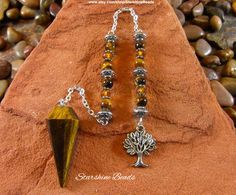 https://www.etsy.com/listing/272292824/tigers-eye-tree-pendulum-tigers-eye?ref=shop_home_active_11