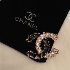 Not authentic. Be among the first in the world to wear this stunning CHANEL style brooch with gold color edges. Elegant size.   From daily wear to entertaining and weddings. Can be used on your jacket, sweater, hat, belt, bag, scarf, etc.   Very glamorous and sophisticated!    Nice gift for yourself!  This CHANEL style pin brooch, brand new, and unused. And in perfect condition as all CHANEL style items.