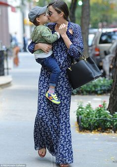 Give us a kiss: Miranda Kerr and Flynn Bloom give each other a kiss on the lips as they publicly show their affection for each other