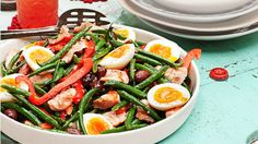 Nicoise Salad  -  options: -canned or fresh salmon -other cooked fish or shrimp -poached eggs -dill and parsley for herbs -pesto thinned w/ oil & wht. wine vinegar for dress. -iceburg lettuce or spinach -add red peppers & kernel corn