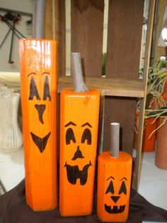 Rustic Jackolanterns made from leftover landscape timber pieces.