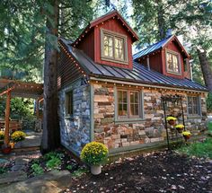 "Storybook Stone Cottage  Tucked beneath huge pines and built right on a mountain stream so close, you'll swear it's running through the living room. Just off the main deck, take the bridge over the stream to the hot tub and the ""Bird House"", a tiny stone house with a second-story sleeping loft."
