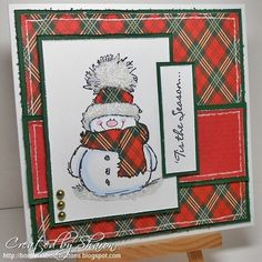 Snowman, like the scarf and background matching.                                                                                                                                                                                 More