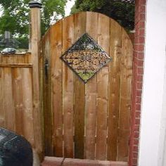 back gate idea;  want to use part of the metal fencing as accent inlets