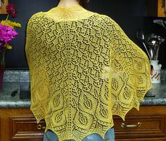 Omelet is a half circle shawl with a garter stitch border that is knit from center back to the bottom edge. Yarnovers at each end and between panels are used to form the shape. Increases are worked every four rows on right side only.