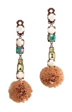 Tory Burch's Pom-Pom Raffia drop earring is an instant mood lifter, whether you're warm weather-bound or simply traveling around town.