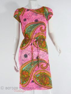 1960s dress in psychedelic pink and green paisley print. The colors are even more vibrant in person, and the enormous paisley and roses print on deep fuchsia pink gro