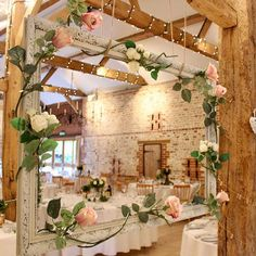 Pretty home-made photo booth framing the South Barn as a backdrop at Upwaltham Barns, West Sussex Photo Booth Frame, Photo Booth Backdrop, Upwaltham Barns, Wedding Decorations, Table Decorations, Wedding Ideas, Wedding Photo Booth, Big Flowers, Flower Photos