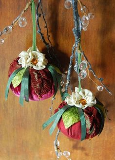 I have worked one in Dupion silk and one in hand dyed silk velvet. Each has velvet and gathered ribbon leaves crowned with Hanah silk ribbon flowers and crystal beads.