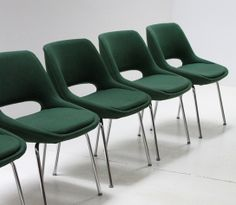 A set of ten Mini-Kilta chairs designed in 1955 by finish designer Olli Mannermaa and produced by the spanish company Mobilplast. Chromed metal bases with an unusual dark green fabric upholstery