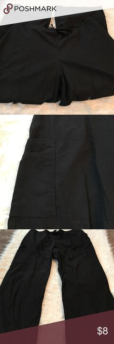 Black XL petite scrub pants Gently used but looks brand-new no flaws. Petite extra-large scrub pants. 65% polyester 35% cotton. There's a pocket on the side and on the back. 40 inch waist. 27 inch long...Price is firm since posh takes $3 dollars of sale scrubs Pants
