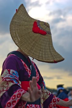 The hidden face would bring you a lot of imagination.  A dancer in traditional costume at a  Japanese festival.
