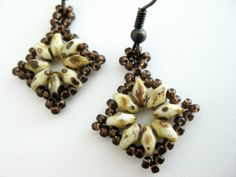 Beadwoven earrings! Made of Czech super duo beads in chalk travertine dark and Japanese seed beads in rusty brown.