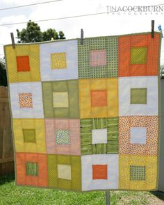 """Quick quilt.  4"""" center squares and 3"""" strips for blocks. Straight line quilting."""