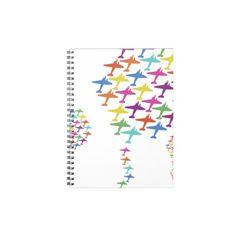 飛行機モチーフのカラフルなノート。見る度に和やかな気分になれそう。ストレスの多い職場にいいかも? #zazzle #ノート