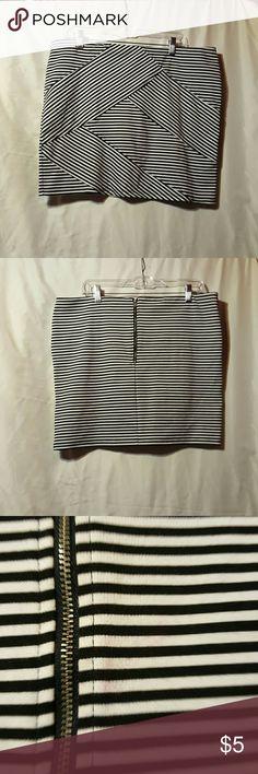 Black and white striped skirt Mini skirt, with paneled stripes. Has a good stretch to it. Very minor, light marking near zipper. Xhilaration Skirts Mini