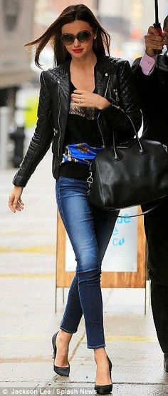 pair of skinny jeans, printed top, leather jacket and black stilettos