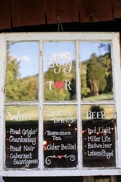 drink menu written on window panes. Could also be old for seating chart.