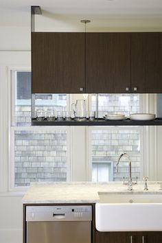 Cabinet and open shelving above a kitchen island - Vaughan residence - Contemporary kitchen