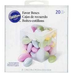 These stylish white favor boxes feature a clear heart cutout on each side, letting the colorful treats within shine through.