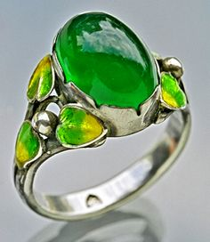 GEORGE HUNT 1892-1960  Arts & Crafts Ring   Silver Enamel Chalcedony  H: 1.4 cm (0.55 in) W: 2 cm (0.79 in)  Marks: Monogram: 'GH' in a shield  British, c.1930