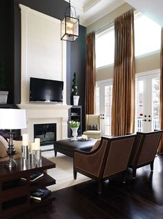 Dramatic black accent wall, high ceilings, warm camels