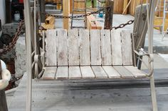Refurbished patio swing. When the material was bleached out and torn my dad replaced it with old barn lumber. Love it!!