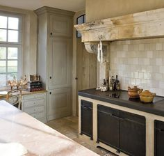 Belgian style kitchen w/ range under antique stone ... | Home inspira ...