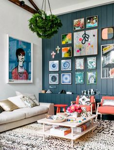 Dark blue painted panelled wall behind armchairs, backdrop to art gallery