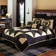 "Carpenter's Star quilt design features a large center star in black and charcoal grey, accented with a cream ticking stripe fabric. This product ships directly from our supplier. 100% pre-washed cotton shell and fill. Quilts and shams are fully sized and feature intricate piecing with hand quilted details. Filling is a high grade, thick bleached virgin cotton to deliver a fuller look.   Quilt Measurements: Queen - 94"" x 94""; King - 110"" x 97""; Luxury King - 120"" x 105"". #country #bedding"