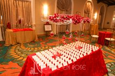 White branches with Orchids and hanging globes with LED lights and petals for centerpiece on card table