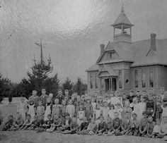 Group portrait of children and adults in front of the second Lankershim Elementary School, built in 1889. San Fernando Valley Historical Society. San Fernando Valley History Digital Library.