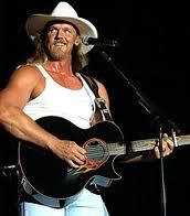 "Tracy Darrell ""Trace"" Adkins is an American country music artist and actor. He made his debut in 1995 with the album Dreamin' Out Loud, released on Capitol Records."