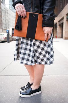 {Checkered Spring Dress | Simply Audree Kate} Flat orange and black clutch with gold initials and tassel