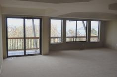 Choice Construction, Remodel, Custom Homes, Gig Harbor, Great Room, Trey Ceiling, Coffer Ceiling, Deck, View