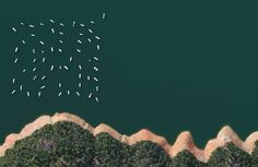 Houseboats float along the New Bullard Bar Reservoir in Yuba County California. Reprinted with permission from Overview by Benjamin Grant, copyright (c) 2016. Published by Amphoto Books, a division of Penguin Random House, Inc.   Images (c) 2016 by DigitalGlobe, Inc.