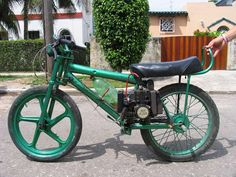 The rikimbili, prohibited, but widely used in Cuba, is made of a bicycle with a motor attached. This bicycle has a soda bottle for a fuel tank. Photo by Ernesto Oroza