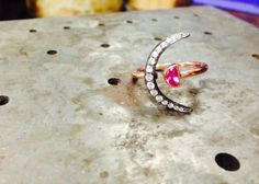 Diamond crescent and sapphire half-moon ring. www.beamillen.com