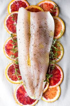 TROUT steamed in parchment with blood oranges and thyme