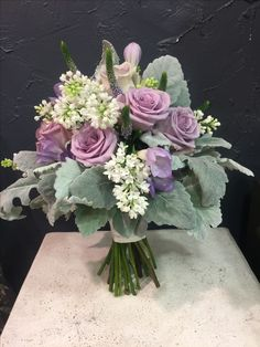 Marvelous Bridal bouquet with Amnesia roses, white lilac, veronica, freesia, silver leaves,