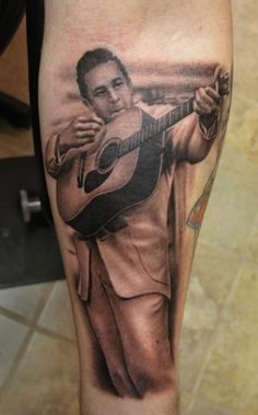 Johnny Cash with Guitar Tattoo by Shane O'Neill #tattoo #tattoos #Ink #JohnnyCash #ShaneONeill http://tattoopics.org/johnny-cash-with-guitar-tattoo-by-shane-oneill/