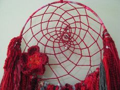 $ 65.00 ♡I handmade this beautiful RUBY RED one of a kind dreamcatcher from thrifted and salvaged materials including wool, novelty yarns, a crochet flower I have handmade myself with the addition of a lovely vintage teardrop crystal salvaged from a chandelier and beads that I have collected over the years.